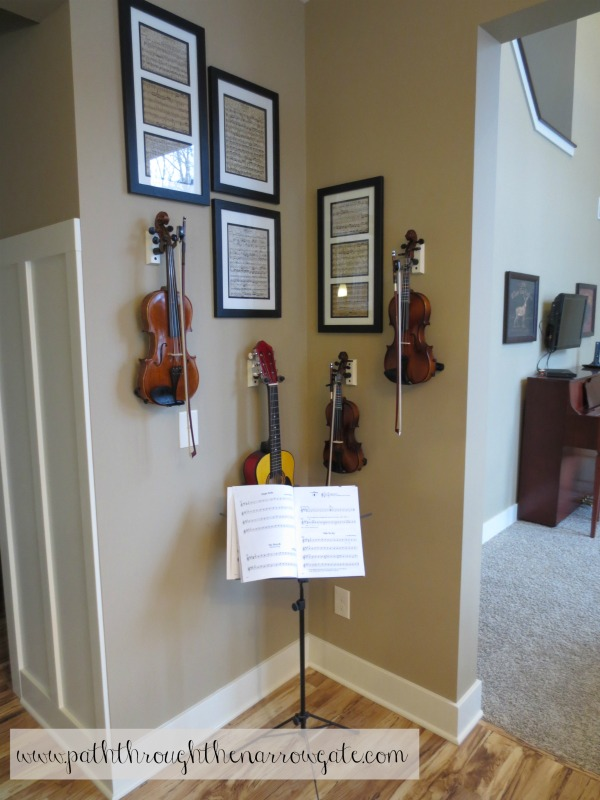 I need a way to store my instruments so they are out of the way, yet easily accessible so my kids will practice more. This is a perfect solution, and I love the framed music wall art!