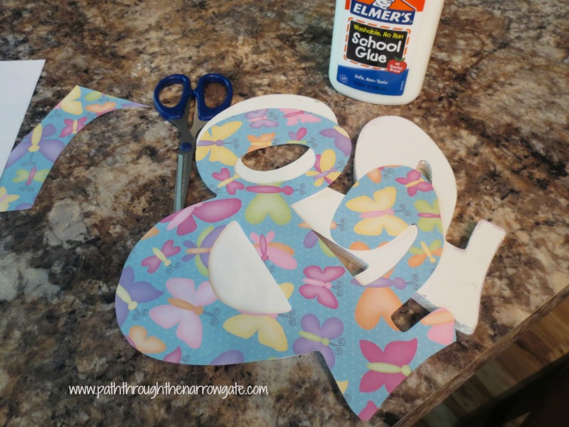 This inexpensive and simple craft is a great way to personalize any room. These would also be great for wedding or baby shower decorations.