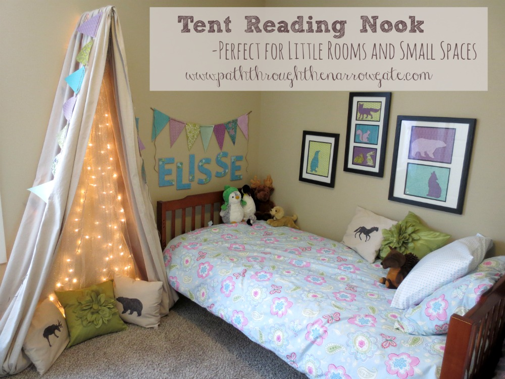 """Would you love to make your kids tent reading nook, but are short on space? This """"tent"""" is exactly what you need! Simple to make, this wall mounted tent has tons of personality and is a fun addition to any child's room."""